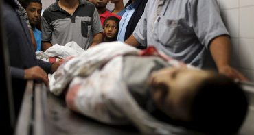 ATTENTION EDITORS - VISUAL COVERAGE OF SCENES OF INJURY OR DEATH  Palestinians gather around the body of Palestinian boy Marwan Barbakh,12, who was shot dead by Israeli forces on Saturday, at a hospital morgue in Khan Younis in the southern Gaza Strip October 10, 2015. Israeli security forces on Saturday shot dead two Palestinians aged 12 and 15, one of them Barbakh, in protests along Gaza's border fence, Palestinian medics said, and Israeli police said they killed three Palestinian assailants in separate violence in Jerusalem. REUTERS/Ibraheem Abu Mustafa